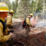crew leader and teacher inspecting wildland firefighters