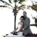 bride and groom by beach gc