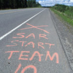 Old marking on the Yellowhead 16 Hwy marking the location where Team 10 of the Burns Lake Search & Rescue started their sweep during their search for Nicole Hoar.