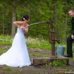 Bride pumping water at farm