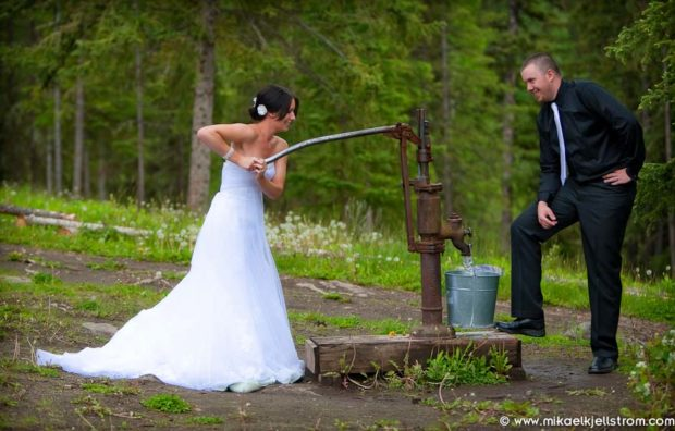 Bride pumping water at farm