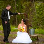 Bride Groom by farm hand pump