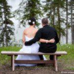 Wedding couple sitting on bench